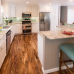Kitchen with granite counters and wood floors