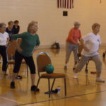 Senior women working out in gym